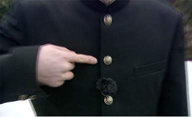 segundo botón del uniforme